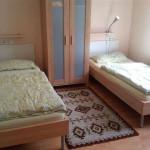 Ansicht Schlafzimmer, Kleiderschrank, 3 Betten Zimmer